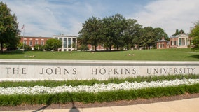 Johns Hopkins University warns of layoffs, cuts while tracking coronavirus spread