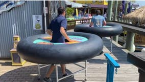 Ocean City bar promotes social distancing with giant inflatable inner tube tables