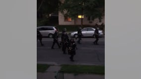 Video: Law enforcement fires paint projectile at residents on porch during curfew in Minneapolis