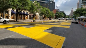 'Black Austin Matters' painted onto Congress Avenue in downtown Austin