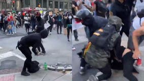 DC protesters tackle man ripping up sidewalk with hammer, hand him to police