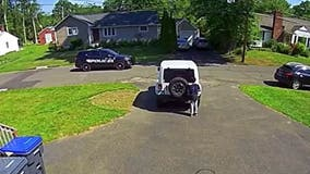 Video shows 10-year-old boy stopping driveway basketball game to hide from passing police car