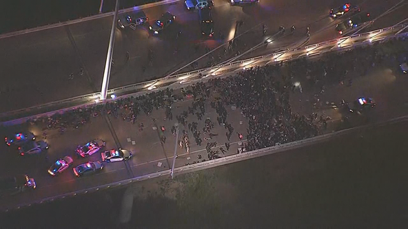 Protesters taken into custody while trying to cross West Dallas bridge