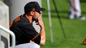 San Francisco Giants manager Gabe Kapler, players kneel during anthem