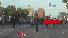 LAPD video shows protester with hands up being shot with less-than-lethal round