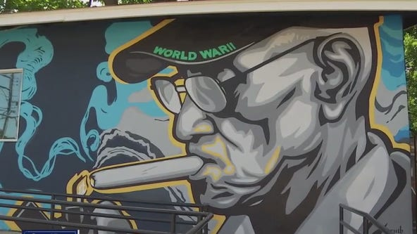 'The Cigar Vault' opening with giant Richard Overton mural on the side