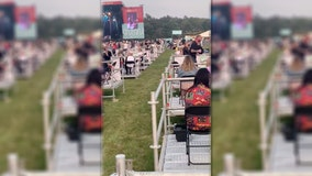 Attendees sit on own platforms at socially distanced outdoor concert held in UK amid pandemic