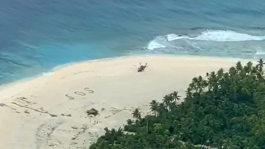 3 men rescued from Pacific island after writing SOS in sand
