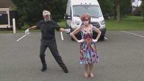 Duo ballroom dances several times a week in empty high school parking lot