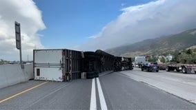 Hurricane-force winds blow over dozens of semi-trucks in Utah
