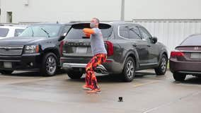 Dad dances in hospital parking lot to lift son's spirits during cancer treatment