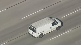 Police pursuit ends after driver surrenders, cargo van rolls down street