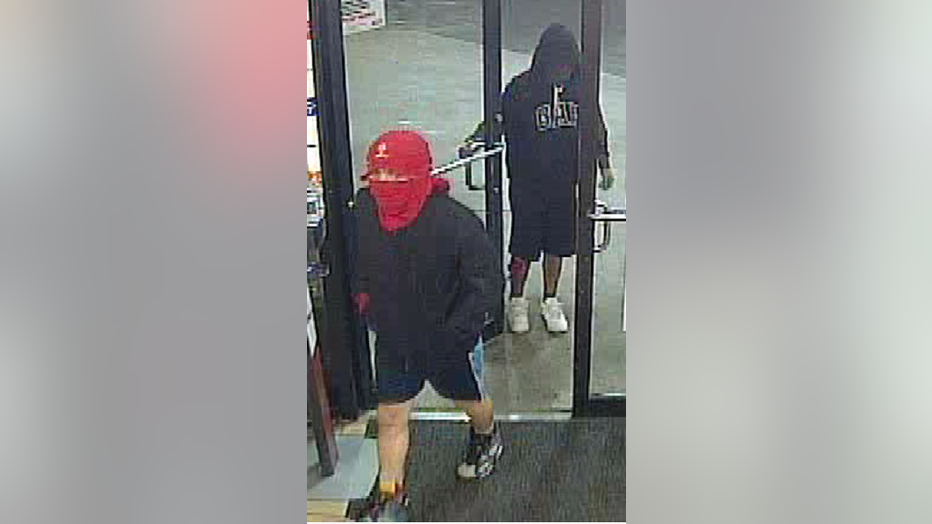 The suspects entered a convenience store armed with multiple handguns, assaulted the clerk, and stole money and other items.