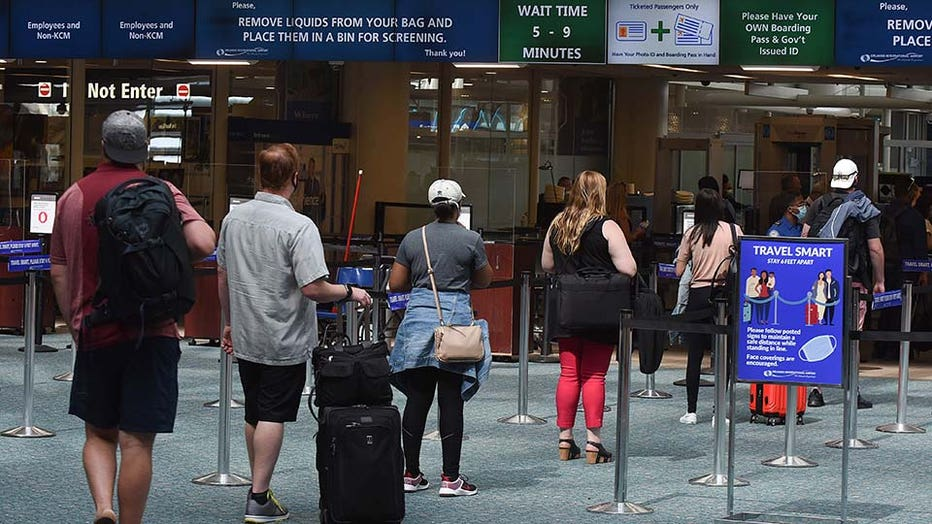c66537d6-A sign reminding passengers to stay 6 feet apart is seen at