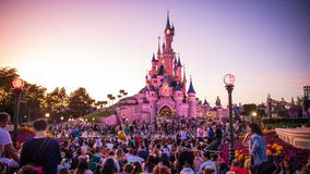 Woman smacks boyfriend on the head during Disneyland proposal, says she thought he was 'trolling'