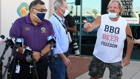 Man wearing 'BBQ, BEER, FREEDOM' shirt crashes Nevada election press briefing