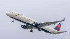 Passengers open Delta jet cabin door, exit via slide at LaGuardia