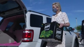 Ivanka Trump helps hand out boxes of food at South Florida distribution event