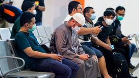 Body parts, debris found after Indonesia plane crash