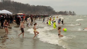 Tradition stands: Polar bear plungers take Bradford Beach by storm