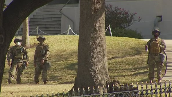 Armed DPS guards pepper lawn of Texas State Capitol during closure