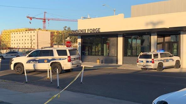 Man holding a baby, firing a gun, shot by Phoenix Police and dies