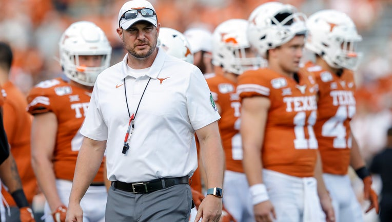Head coach Tom Herman of the Texas Longhorns watches players warm up before the game against the Oklahoma State Cowboys at Darrell K Royal-Texas Memorial Stadium on September 21, 2019 in Austin, Texas.