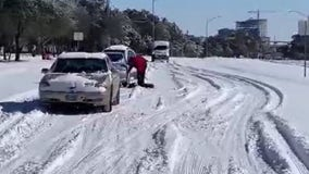 Crews work to plow and maintain roads after rare Texas snow storm