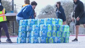City of Austin distributes cases of water to people in need