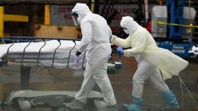 US COVID-19 death toll surpasses 450,000