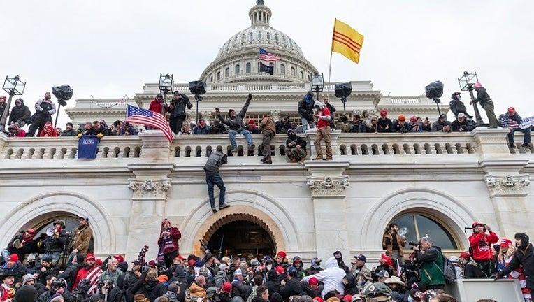 Protesters seen all over Capitol building where pro-Trump