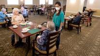 Nursing homes battered by COVID-19 begin easing rules on visitors