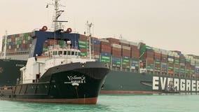 Massive cargo ship the size of a skyscraper turns sideways, blocking Suez Canal