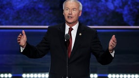 Arkansas governor signs legislation banning nearly all abortions in the state