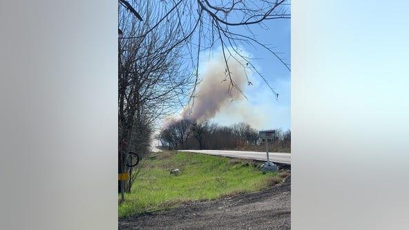 Crews battle 150-acre brush fire in Southeast Travis County