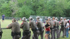 DPS troopers attend injured trooper's son's baseball game