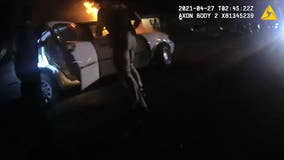'They literally ran toward the flames': Police rescue unconscious woman from burning car