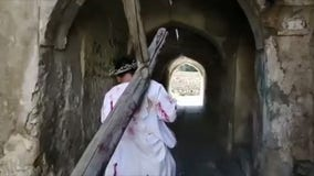 Iraqi Christians reenact Jesus carrying the cross on Good Friday