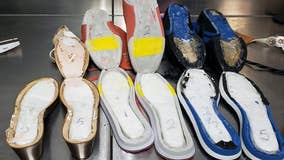 Woman caught at Atlanta airport smuggling cocaine in shoes, officials say