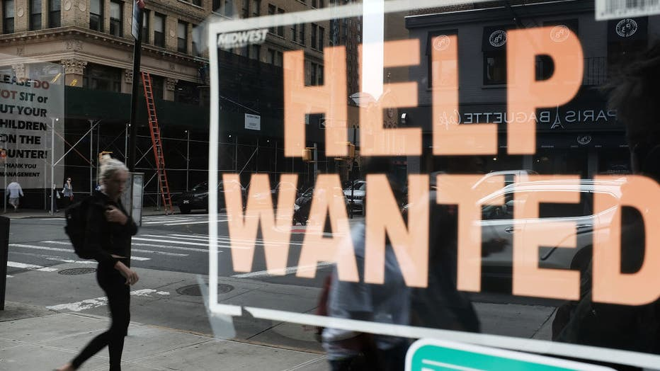 A help wanted sign is displayed in the window of a Brooklyn business on Oct. 5, 2018 in New York, United States. (Photo by Spencer Platt/Getty Images)
