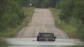 Driver stuck at low water crossing rescued by helicopter