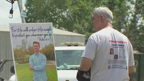 Family of Jason Landry set up booth at Luling festival