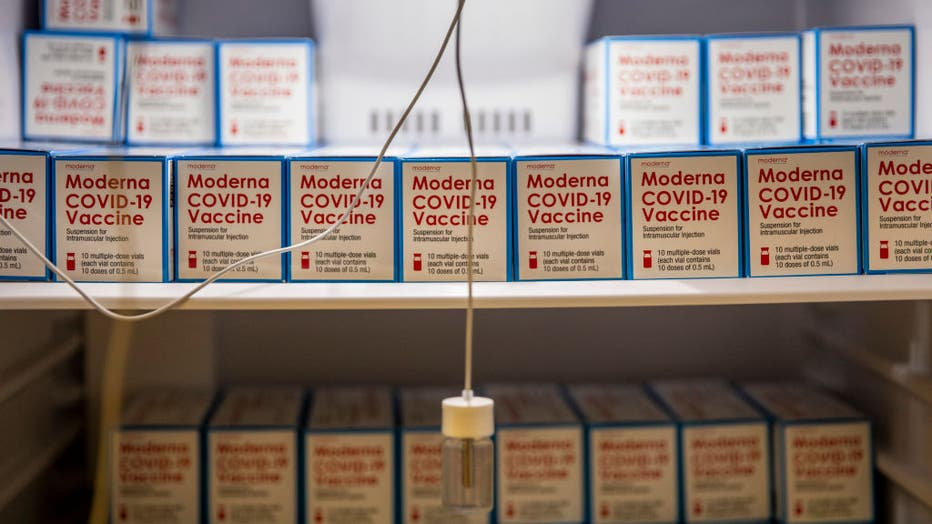 Boxes of the Moderna COVID-19 vaccine sitting in freezers