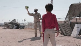 US soldiers play with evacuee Afghan children in Texas