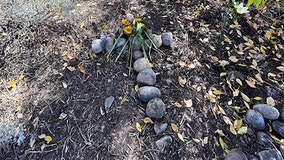 Gabby Petito's stepfather lays stone cross at spot where remains were found