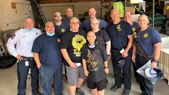 AFD members shave their heads to support boy with bone cancer