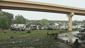 One RV swept away, another turned on its side following heavy rain