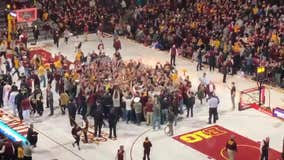 Gophers beat Purdue, fans storm the court