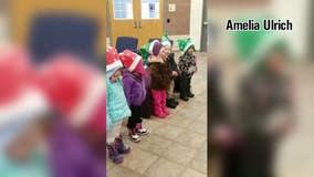 Kid carolers spread Christmas cheer in Hugo