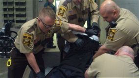 Community leaders, county board condemn corrections officer's use of excessive force